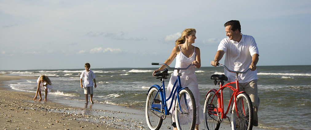 Walking bicycles on Clearwater Beach